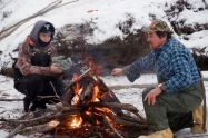 If you are going to ice fish, you need a fire. Albert and Alfred warm themselves.