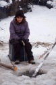 Debbie, our principal, tries her hand at ice fishing with a line.